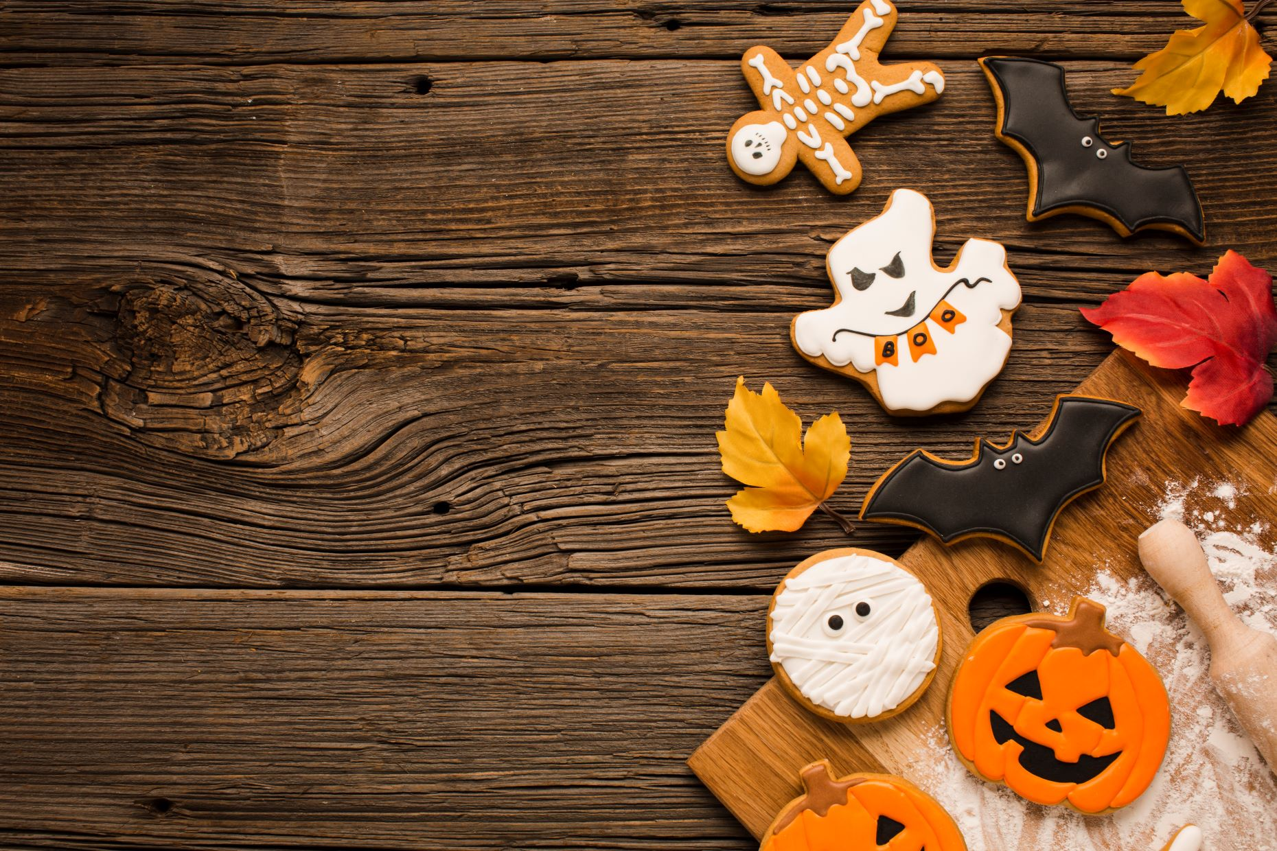 Wooden table with Halloween-themed cookies on it