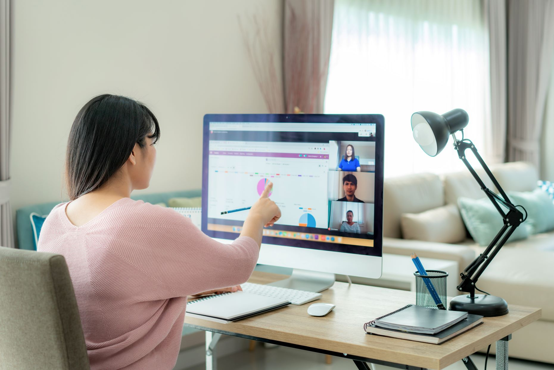 Woman participating in video conference call
